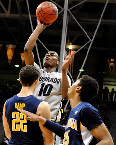 University of Colorado sophomore Alec Burks takes a shot over California junior Harper Kamp during the second round of the NIT basketball tournament against the University of California on Friday, March 18, at the Coors Event Center in Boulder. CU defeated California 89-72. For more photos go to www.dailycamera.com Jeremy Papasso/ Camera