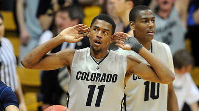 """Cory Higgins of CU is """"trying"""" to hear the crowd during the second half of the March 18, 2011 NIT game in Boulder, Colo. For more photos of the game, go to www.dailycamera.com. Cliff Grassmick / March 18, 2011"""