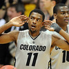 "Cory Higgins of CU is ""trying"" to hear the crowd during the second half of the March 18, 2011 NIT game in Boulder, Colo.<br /> For more photos of the game, go to  <a href=""http://www.dailycamera.com"">http://www.dailycamera.com</a>.<br /> Cliff Grassmick / March 18, 2011"