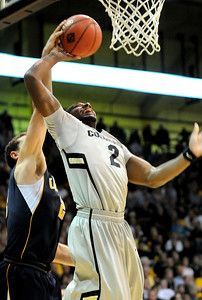 Shannon Sharpe has his shot blocked during the game against the University of California at the Coors Event Center in Boulder on Friday, March 18,2011. For more photos go to www.dailycamera.com (Phil McMichael/ Camera)