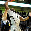 "Shannon Sharpe has his shot blocked during the game against the University of California at the Coors Event Center in Boulder on Friday, March 18,2011. For more photos go to  <a href=""http://www.dailycamera.com"">http://www.dailycamera.com</a> (Phil McMichael/ Camera)"