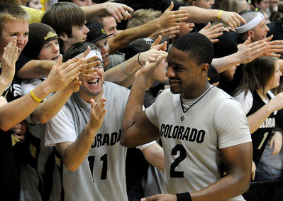 Shannon Sharpe gives fans high fives after defeated the University of California at the Coors Event Center. For more photos go to www.dailycamera.com (Phil McMichael/ Camera)