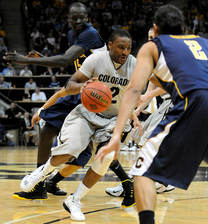 "Shannon Sharpe drives to the basket against the University of California at the Coors Event Center in Boulder on Friday, March 18,2011. For more photos go to  <a href=""http://www.dailycamera.com"">http://www.dailycamera.com</a> (Phil McMichael/ Camera)"