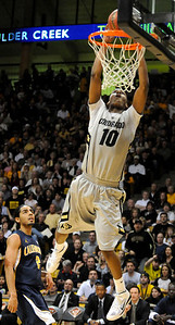 Alec Burks goes up for a dunk during the first half of the game versus the University of California at the Coors Event Center in Boulder on Friday, March 18,2011. For more photos go to www.dailycamera.com (Phil McMichael/ Camera)