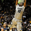 "Alec Burks goes up for a dunk during the first half of the game versus the University of California at the Coors Event Center in Boulder on Friday, March 18,2011. For more photos go to  <a href=""http://www.dailycamera.com"">http://www.dailycamera.com</a> (Phil McMichael/ Camera)"