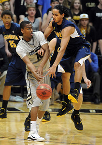 Alec Burks of Colorado gets the ball around Jorge Gurierrez of California during the first half of the March 18, 2011 NIT game in Boulder, Colo. For more photos of the game, go to www.dailycamera.com. Cliff Grassmick / March 18, 2011