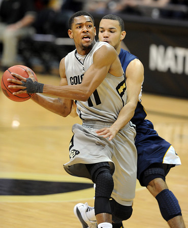 "Cory Higgins of Colorado takes of with a steal from Emerson Murray, right,  of California <br /> during the second half of the March 18, 2011 NIT game in Boulder, Colo.<br /> For more photos of the game, go to  <a href=""http://www.dailycamera.com"">http://www.dailycamera.com</a>.<br /> Cliff Grassmick / March 18, 2011"
