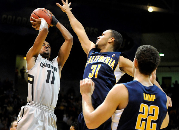 "University of Colorado senior Cory Higgins takes a shot over California freshman Emerson Murray during the second round of the NIT basketball tournament against the University of California on Friday, March 18, at the Coors Event Center in Boulder. For more photos go to  <a href=""http://www.dailycamera.com"">http://www.dailycamera.com</a><br /> Jeremy Papasso/ Camera"