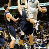 "Austin Dufault passes the ball in the game versus the University of California at the Coors Event Center in Boulder on Friday, March 18,2011. For more photos go to  <a href=""http://www.dailycamera.com"">http://www.dailycamera.com</a> (Phil McMichael/ Camera)"