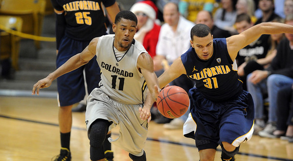 """Cory Higgins of Colorado takes of with a steal from Emerson Murray of California <br /> during the second half of the March 18, 2011 NIT game in Boulder, Colo.<br /> For more photos of the game, go to  <a href=""""http://www.dailycamera.com"""">http://www.dailycamera.com</a>.<br /> Cliff Grassmick / March 18, 2011"""