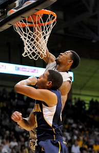 Cory Higgins dunks the ball during the game versus the University of California at the Coors Event Center in Boulder on Friday, March 18,2011. For more photos go to www.dailycamera.com (Phil McMichael/ Camera)