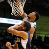 """Cory Higgins dunks the ball during the game versus the University of California at the Coors Event Center in Boulder on Friday, March 18,2011. For more photos go to  <a href=""""http://www.dailycamera.com"""">http://www.dailycamera.com</a> (Phil McMichael/ Camera)"""