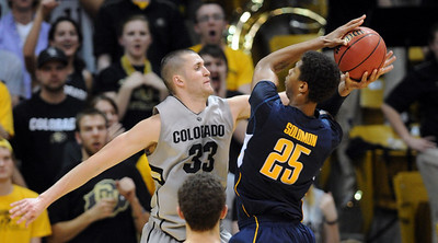 Austin Dufault of CU fouls Richard Solomon of Cal during the second half of the March 18, 2011 NIT game in Boulder, Colo. For more photos of the game, go to www.dailycamera.com. Cliff Grassmick / March 18, 2011