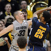 "Austin Dufault of CU fouls Richard Solomon of Cal during the second half of the March 18, 2011 NIT game in Boulder, Colo.<br /> For more photos of the game, go to  <a href=""http://www.dailycamera.com"">http://www.dailycamera.com</a>.<br /> Cliff Grassmick / March 18, 2011"