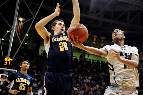 """University of Colorado sophomore Alec Burks drives past California junior Harper Kamp during the second round of the NIT basketball tournament against the University of California on Friday, March 18, at the Coors Event Center in Boulder. For more photos go to  <a href=""""http://www.dailycamera.com"""">http://www.dailycamera.com</a><br /> Jeremy Papasso/ Camera"""