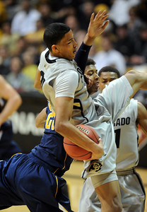 Andre Roberson of Colorado comes down with a rebound while fending off Richard Solomon of California  during the first half of the March 18, 2011 NIT game in Boulder, Colo. For more photos of the game, go to www.dailycamera.com. Cliff Grassmick / March 18, 2011