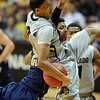 "Andre Roberson of Colorado comes down with a rebound while fending off Richard Solomon of California <br /> during the first half of the March 18, 2011 NIT game in Boulder, Colo.<br /> For more photos of the game, go to  <a href=""http://www.dailycamera.com"">http://www.dailycamera.com</a>.<br /> Cliff Grassmick / March 18, 2011"