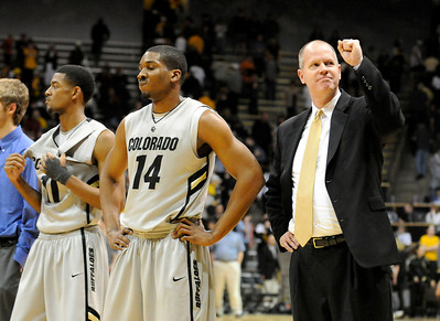 Tad Boyle gives a fist pump to the crowd after CU defeated the University of California 89-72. For more photos go to www.dailycamera.com (Phil McMichael/ Camera)