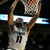 "Cory Higgins dunks the ball during the game versus the University of California at the Coors Event Center in Boulder on Friday, March 18,2011. For more photos go to  <a href=""http://www.dailycamera.com"">http://www.dailycamera.com</a> (Phil McMichael/ Camera)"