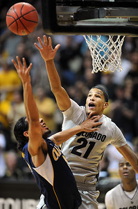 Andre Roberson of Colorado goes up to block the shot of Jorge Gutierrez of California during the first half of the March 18, 2011 NIT game in Boulder, Colo. For more photos of the game, go to www.dailycamera.com. Cliff Grassmick / March 18, 2011