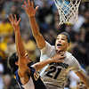 "Andre Roberson of Colorado goes up to block the shot of Jorge Gutierrez of California during the first half of the March 18, 2011 NIT game in Boulder, Colo.<br /> For more photos of the game, go to  <a href=""http://www.dailycamera.com"">http://www.dailycamera.com</a>.<br /> Cliff Grassmick / March 18, 2011"