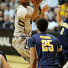 "Alec Burks of Colorado drive the lane against California during the first half of the March 18, 2011 NIT game in Boulder, Colo.<br /> For more photos of the game, go to  <a href=""http://www.dailycamera.com"">http://www.dailycamera.com</a>.<br /> Cliff Grassmick / March 18, 2011"
