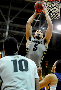 University of Colorado senior Marcus Relphorde drives towards the hoop during the second round of the NIT basketball tournament against the University of California on Friday, March 18, at the Coors Event Center in Boulder. CU defeated California 89-72. For more photos go to www.dailycamera.com Jeremy Papasso/ Camera