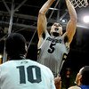 "University of Colorado senior Marcus Relphorde drives towards the hoop during the second round of the NIT basketball tournament against the University of California on Friday, March 18, at the Coors Event Center in Boulder. CU defeated California 89-72. For more photos go to  <a href=""http://www.dailycamera.com"">http://www.dailycamera.com</a><br /> Jeremy Papasso/ Camera"