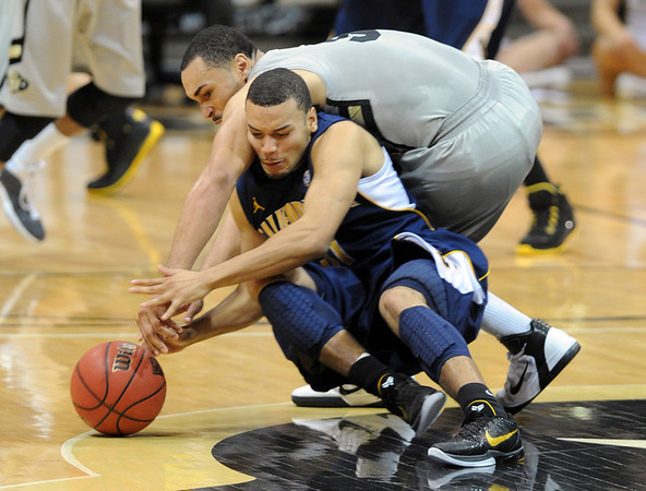 """Marcus Relphorde of CU tries to get a steal from Emerson Murray of Cal during the second half of the March 18, 2011 NIT game in Boulder, Colo.<br /> For more photos of the game, go to  <a href=""""http://www.dailycamera.com"""">http://www.dailycamera.com</a>.<br /> Cliff Grassmick / March 18, 2011"""