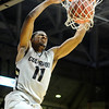 "University of Colorado senior Cory Higgins dunks the ball during the second round of the NIT basketball tournament against the University of California on Friday, March 18, at the Coors Event Center in Boulder. CU defeated California 89-72. For more photos go to  <a href=""http://www.dailycamera.com"">http://www.dailycamera.com</a><br /> Jeremy Papasso/ Camera"