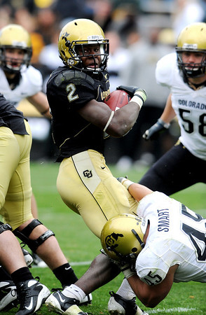 S0426CUFB106.JPG Darrell Scott fights for yards in the CU spring game on Saturday.<br /> Cliff Grassmick / April 25, 2009