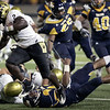 Colorado_Toledo_Football_OH(6).JPG Colorado's Darrell Scott (2) runs the ball past Toledo's Archie Donald during the first half of an NCAA college fotball game on Friday, Sept. 11, 2009 in Toledo, Ohio. (AP Photo/J.D. Pooley)