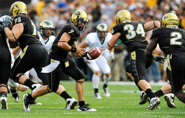 S0907CU006.jpg CU's COdy Hawkins (7) turns to give the ball to Darrell Scott (2) at the annual Rocky Mountain Showdown in Folsom Field in Boulder, Colorado on Sunday, Sept. 6, 2009.<br /> KASIA BROUSSALIAN / THE CAMERA