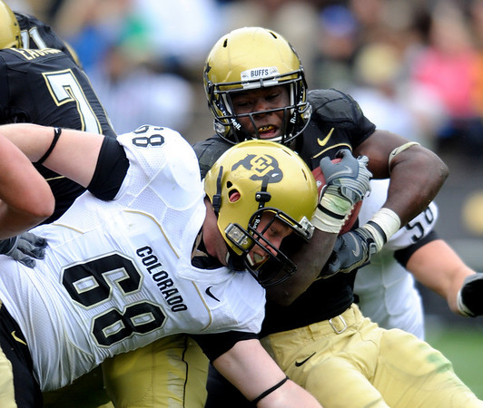 S0426CUFB109.JPG Darrell Scott fights for yards  against Joe Silipo  (68) in the CU spring game on Saturday.<br /> Cliff Grassmick / April 25, 2009
