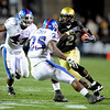 S1019CUKU208.JPG Darrell Scott  of CU takes off with a screen pass against Kansas.<br /> Cliff Grassmick / October 17, 2009