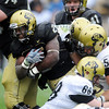 S0426CUFB113.JPG Darrell Scott fights for yards in the CU spring game on Saturday.<br /> Cliff Grassmick / April 25, 2009
