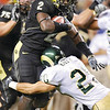 DSC_8574.JPG_DSC_8574.JPG.jpg CMYK<br /> Colorado running back Darrell Scott (2) runs into Colorado State defender Klint Kubiak (20) in the second half at Invesco Field in Denver on Sunday. The Buffs went on to win 38-17 over the Rams and claim the Centennial Cup trophy for the second year-in-a-row.<br />   <br /> Photo by Joshua Lawton / Camera / Aug. 31, 2008<br /> DSC_8574.JPG