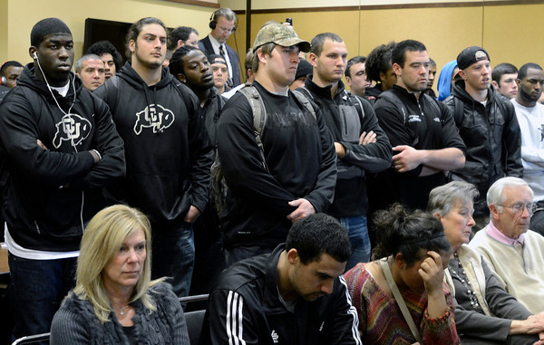 """Jon Embree Fired021.JPG The University of Colorado football team, including Chidera Uzo-Diribe, left and David Bakhtiari stand behind Natalyn Embree, front left, Taylor Embree, center, and Hannah Embree as they listen to Former University of Colorado Head Coach Jon Embree speak about his departure from the program during a press conference on Monday, Nov. 26, at the Dal Ward Athletic Center on the CU campus in Boulder. For more photos and video of the press conference go to  <a href=""""http://www.dailycamera.com"""">http://www.dailycamera.com</a><br /> Jeremy Papasso/ Camera"""