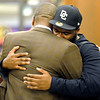 """Jon Embree Fired012.JPG Tears run down the face of freshman De'Jon Wilson as he hugs former University of Colorado Head Coach Jon Embree speaks during a press conference on Monday, Nov. 26, at the Dal Ward Athletic Center on the CU campus in Boulder. For more photos and video of the press conference go to  <a href=""""http://www.dailycamera.com"""">http://www.dailycamera.com</a><br /> Jeremy Papasso/ Camera"""