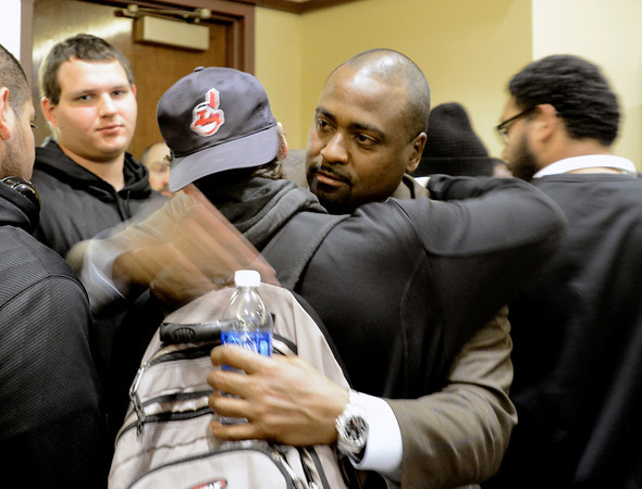 Former Head Football Coach Jon Embree hugs his players after speaking to the media on Monday November 26 at the Dal Ward Center on the University of Colorado Boulder Campus. Embree was fired from his position on Sunday.<br /> Jeremy Papasso/ Camera