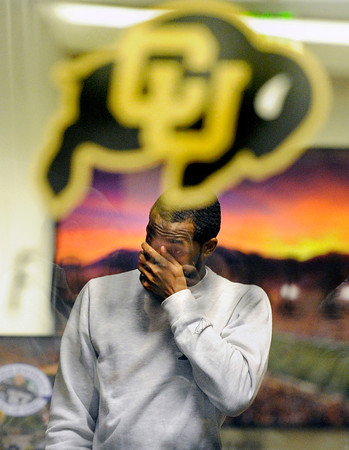 """Jon Embree Fired013.JPG University of Colorado junior Paul Richardson wipes tears from his face after saying goodbye to Head Coach Jon Embree in his office after a press conference on Monday, Nov. 26, at the Dal Ward Athletic Center on the CU campus in Boulder. For more photos and video of the press conference go to  <a href=""""http://www.dailycamera.com"""">http://www.dailycamera.com</a><br /> Jeremy Papasso/ Camera"""