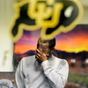 "Jon Embree Fired013.JPG University of Colorado junior Paul Richardson wipes tears from his face after saying goodbye to Head Coach Jon Embree in his office after a press conference on Monday, Nov. 26, at the Dal Ward Athletic Center on the CU campus in Boulder. For more photos and video of the press conference go to  <a href=""http://www.dailycamera.com"">http://www.dailycamera.com</a><br /> Jeremy Papasso/ Camera"