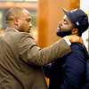 "Tears run down the face of freshman De'Jon Wilson as he hugs former University of Colorado Head Coach Jon Embree speaks during a press conference on Monday, Nov. 26, at the Dal Ward Athletic Center on the CU campus in Boulder. For more photos and video of the press conference go to  <a href=""http://www.dailycamera.com"">http://www.dailycamera.com</a><br /> Jeremy Papasso/ Camera"