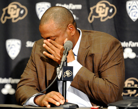 Former Head Football Coach Jon Embree sheds tears as he talks to the media on Monday November 26 at the Dal Ward Center on the University of Colorado Boulder Campus. Embree was fired from his position on Sunday.<br /> Jeremy Papasso/ Camera