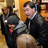 CU Athletic Director, Mike Bohn, talks about Jon Embree's daughter, Hannah, left.<br /> New University of Colorado football coaches, Jon Embree, and Eric Bieniemy arrived at Denver Air Center in Broomfield on Sunday night. They will be introduced at 10 a.m. Monday at Folsom Field.<br /> Cliff Grassmick / December 5, 2010