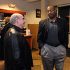 New University of Colorado football coache, Jon Embree, talks to CU Chancellor Phil DiStephano after arriving at the  Denver Air Center in Broomfield on Sunday night. They will be introduced at 10 a.m. press conference on Monday at Folsom Field.<br /> Cliff Grassmick / December 5, 2010