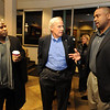 New University of Colorado football coaches, Jon Embree,right, and Eric Bieniemy, talks to CU President Bruce Benson, after arriving at Denver Air Center in Broomfield on Sunday night. They will be introduced at 10 a.m. Monday at Folsom Field.<br /> Cliff Grassmick / December 5, 2010