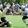 "Matt Bahr, 43, gets upended by Makiri Puch, 16, as Arthur Jaffee, 22, watches during the University of Colorado Football team scrimmage on Saturday August 13, 2011.<br /> For more photos and video interviews from the scrimmage go to  <a href=""http://www.buffzone.com"">http://www.buffzone.com</a> and dailycamera.com<br /> Photo by Paul Aiken  August 13,  2011."