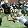 "Rodney Stewart, 5, escapes from Brady Daigh, 54, during the University of Colorado Football team scrimmage on Saturday August 13, 2011.<br /> For more photos and video interviews from the scrimmage go to  <a href=""http://www.buffzone.com"">http://www.buffzone.com</a> and dailycamera.com<br /> Photo by Paul Aiken  August 13,  2011."