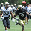 "Paul Richardson, 6, can't reach a pass as he is guarded by Paul Vigo, 32, during the University of Colorado Football team scrimmage on Saturday August 13, 2011.<br /> For more photos and video interviews from the scrimmage go to  <a href=""http://www.buffzone.com"">http://www.buffzone.com</a> and dailycamera.com<br /> Photo by Paul Aiken  August 13,  2011."